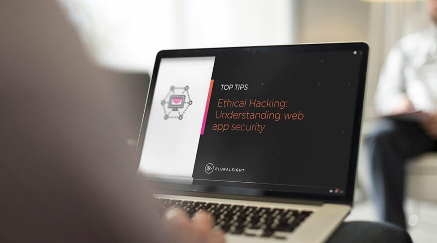 Person with a laptop on the Pluralsight website